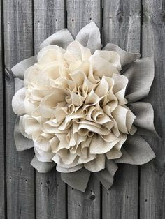 This is a Marigold burlap wreath with ivory petals and grey burlap leaves. It measures to 25-26 in diameter with almost 9 in depth. This is not a weather durable product, this needs protection from the elements, at the minimum a good covered porch. I do spray this wreath with a