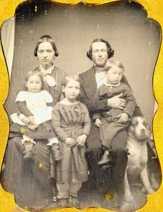 This photo demonstrates why Victorian photographers preferred to use posing stands.   Any movement during the 30 second exposure could cause the image to blur.  Note how blurry the squirmy kids and dog are compared to the parents.