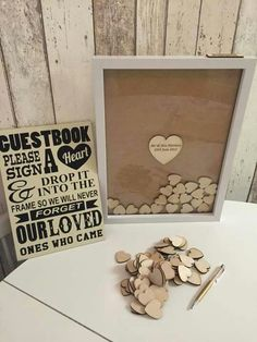 Our Guestbook idea.  We have frame, wood hearts and sign