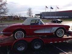 1959 Corvette next to the Corvette Museum in Bowling Green KY