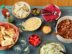 Stave off cold-weather blues with a comforting bowl of Ree Drummond& Chipotle Chicken Chili, plus easy sides and queso dip. Made to feed a crowd, these dishes are perfect for casual entertaining. Korma, Biryani, Food Network Recipes, Cooking Recipes, Easy Recipes, Top Recipes, Chili Recipes, Delicious Recipes, Cooking Tips