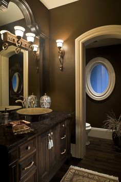 Darker guest bathroom with all the traditional flair many still adore. Great brown paint color and golden sink to match the upgrades. #goldsink #guestbath #bathroom