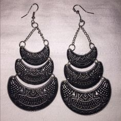 Fashion earrings. Black and silver Aztec fashion earrings. Jewelry Earrings