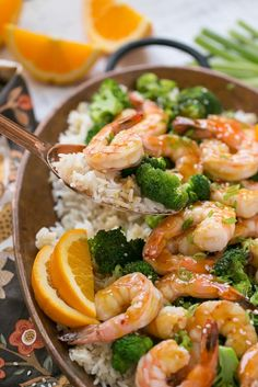 This orange shrimp and broccoli with garlic sesame fried rice is the perfect quick and easy meal for a busy weeknight or for entertaining guests. Salmon And Shrimp, Shrimp And Broccoli, Broccoli Recipes, Fish Dishes, Main Dishes, Seafood Recipes, Cooking Recipes, Easy Recipes, Fisher