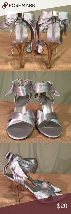 M.P.S. Silver/Zipper & Snap Ankle Strap Bow Heels These shoes have been Very Gently Worn and are in PERFECT CONDITION. The heel height of this shoe is 4 inches tall. M.P.S. Shoes Heels