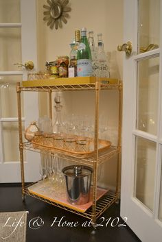 Life & home at 2102: DIY Bar Cart. Silver shelving  add gold spray paint and tray and done!