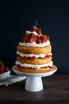 Sky High Strawberry Shortcake: This lofty layer cake reigns strawberry supreme. Get the recipe from Heather Homemade. Food Cakes, Cupcake Cakes, Köstliche Desserts, Dessert Recipes, Bolos Naked Cake, Strawberry Shortcake Recipes, Strawberry Desserts, Salty Cake, Savoury Cake