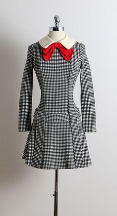 ➳ vintage 1960s Rudi Gernreich dress  * black & white gingham print wool * large red bow accent * detachable belt * matching high socks * back zipper * by designer Rudi Gernreich  condition | excellent fits like small  length 33 bust 34-38 hips 34 shoulders 15-16 sleeves 22  ➳ shop http://www.etsy.com/shop/millstreetvintage?ref=si_shop  ➳ shop policies http://www.etsy.com/shop/millstreetvintage/policy  twitter | MillStVintage facebook | millstreetvintage instagram | millstreetvintage…