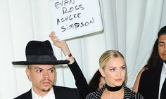 Elton John party handler holds a sign to ID Ashlee Simpson and Evan Ross   Daily Mail Online