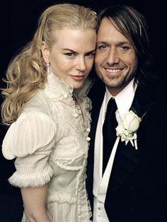 Actress Nicole Kidman and western singer Keith Urban at their reception.  She wore a veil for the wedding.