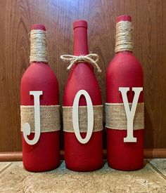 This made-to-order wine bottle set is the perfect compliment to your holiday home decorations. Wine bottles are hand-painted in red chalk-paint and adorned with burlap wrap. Joy letters are cashew colored. Standard wine botte size measuring 12 inches tall. I am happy to take custom