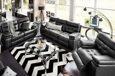 Linger Lavishly. The designer look of the Brisco Black manual reclining sofa starts with lavish Italian leather upholstery. Its casual contemporary style leaves a truly inviting impression in the living room or family room and is just as comfortable as it is handsome.