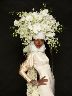 White orchid bridal hat designed B. Michael, Michael  Gaffney, NY School of Floral Design. Photo by Matthew Peyton