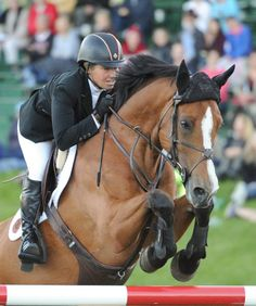 Beezie aboard Amadore in the RBC winning round 1.50m winning round ~ Spruce Meadows