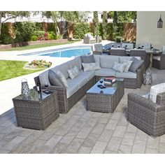 This patio sectional features a beautiful Heather Gray wicker color with 200+ custom order cushion fabrics.