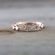 14k Rose Gold Dainty Baguette Cut Rectangle Diamond Band Stackable Design Ring Wedding Twist by ASweetPear on Etsy https://www.etsy.com/listing/265744565/14k-rose-gold-dainty-baguette-cut
