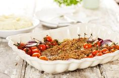 Lombos de peixe no forno com crosta de cereais, ervas e parmesão