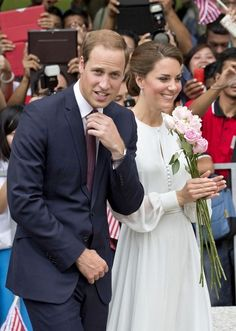 Prince William and Catherine, Duchess of Cambridge attend a cultural event held in Central Park where they are surronded by fans.