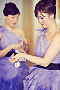 #purple one-shoulder bridesmaid dresses with black sash and spiral ruffles #verawang #lavender #lilac