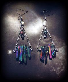 A one of a kind, handmade pair of earrings made with rainbow titanium quartz…