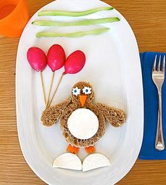 Invite this adorable partying penguin (complete with radish balloons and a goat cheese tummy!) to your child's lunch.