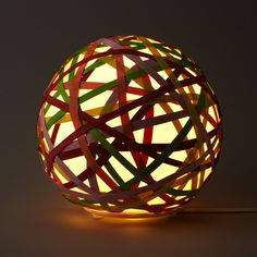 Multi-Color Rubber Band Lamp by uncommongoods: Made of mouth blown glass and custom formed rubber bands. #Lamp #Rubber_Band #uncommongoods