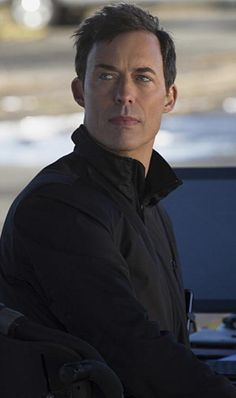 "Harrison Wells played by Tom Cavanagh. Introduced in season one of CW's ""The Flash."""