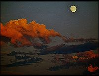 Full Moon and Sunset by Randy Turoff