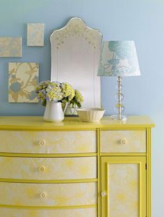 Make a Scene    Who knew wallpaper was so versatile? We used it for three projects in this bedroom. First, we chose a modern floral paper to rejuvenate a tired dresser. We removed the old knobs, cut the paper to size, then affixed it to the drawer fronts. Screw on cute new knobs, and you've just scored a designer-look dresser for a fraction of the price!