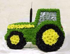 A John Deere Tractor memorial floral tribute.