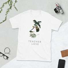 You've now found the staple t-shirt of your wardrobe. It's made of a thicker, heavier cotton, but it's still soft and comfy. And the double stitching on the neckline and sleeves add more durability to what is sure to be a favorite! Teacher Gifts, Men's Fashion, Portraits, Plant, T Shirts For Women, Unisex, Sleeve, Mens Tops, Cotton