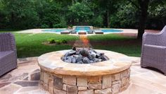 """Using natural gas burners coupled with volcanic stone, or """"fire-glass,"""" is a clean and easy way to incorporate a stone fire pit into a yard, saysBrad Renken of Georgia-based Hearthstone Environments."""