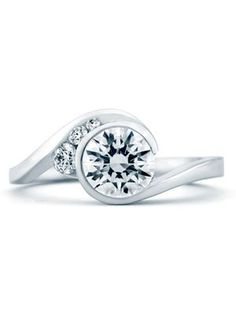 Bezel setting: modern engagement ring via @The Knot
