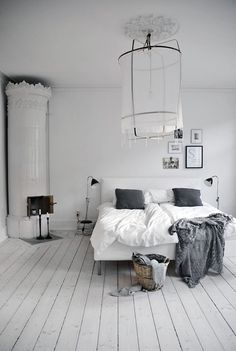 white and gray. And, love the off-center frames above the head board