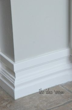 Upgrade builder's grade baseboards without replacing – just add a strip of molding an inch above the original baseboard and paint!