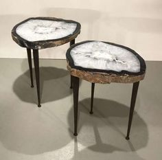 Pair of agate side tables on tapered wrought iron legs with brown bronze finish
