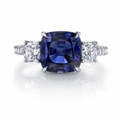 Omi Gems: -Sapphire and diamond 3-stone ring handcrafted with a 3.82 carat cushion sapphire center stone accented with 0.86 carats of cushion cut diamonds and 0.37 carats of brilliant diamond rounds set in platinum.