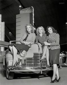 "1939. ""General Motors exhibit, Golden Gate International Exposition, San Francisco. Girls on Oldsmobile convertible coup"