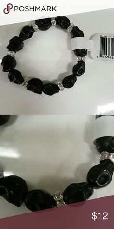 Black Skull and Diamonds Bracelet Super cute black skull bracelet with diamond dividers! They stretch!  I love to offer bundle discounts! Smoke free home.  No trades. Michaels Jewelry Bracelets