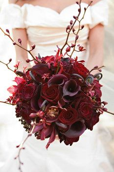 Callas, fern fiddles, arachnis orchids, cymbidium orchids, roses in deep wine maroon colours