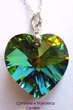 "<3 This gorgeous crystal colour is mainly green, but other colours inside the crystal are visible - green, yellow, orange, dark pink & blue - due to the cut facets & special coating on the back of the crystal, when the crystal moves in the light  <3 .925 Sterling Silver VITRAIL Medium ( Green multi ) 18mm size Crystal Heart Pendant Chain Necklace made with SWAROVSKI ELEMENTS crystal ~ 16"" inch or 18"" inch length chain + Gift Box & Organza Gift Bag ~ by Christine & Francesca Designs"