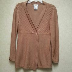 Talbots cardigan Beautiful golden brown color this sweater has a wrap front that is closed with 2 snaps. The rest of the sweater hangs open.  Very elegant look. The top is finely ribbed the rest of the sweater has a flat knit. 90% cotton and 10% alpaca Talbots Sweaters Cardigans