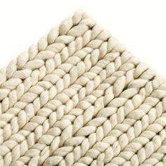 Tapijt in zuivere wol met effect van gevlochten tricot