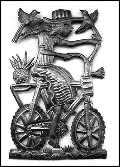 """Bicycling Haitian Woman - Steel Drum Metal Art Wall Hanging - 9"""" x 17""""  - See this and more at www.HaitiMetalArt.com"""
