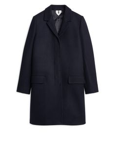 "<p style=""text-align: justify;"">In a style inspired by the classic overcoat, this straight-fitted coat is cut from a heavy wool fabric produced in Italy. A"