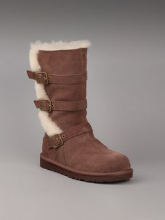 UGG® Australia Youth Maddi Boot in Chocolate.  If you're little darling has an eye for style, she'll love these trendy boots in an edgy style. Features a lush, suede shearling lining and trim with fixed buckles. The flexible EVA outsole provides the right amount of comfort too!