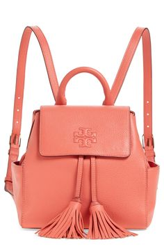 Crushing on this street-savvy, Tory Burch backpack in coral with tassels for extra flair. It's perfect for carrying the essentials hands free.
