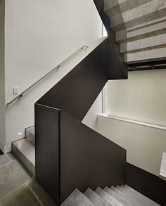 metal mesh risers treads with solid metal railing in modern staircase by DeForest Architects