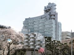 "https://flic.kr/p/dqy1iW | Sky Building Number Three | Daisan Sukai Biru  Architect: Yoji Watanabe Office, 1970  1-1-10 Okubo, Shinjuku-ku, Tokyo  "" A 14-storey office and apartmend building, Sky Building Number Three is the work of the eccentric Yoji Watanabe. The lot is narrow but extended in the north-south direction. The units are angled away from the corridor on both sides to give each some southern exposure; the elevators are situated at the norhern end. The silver painted exterio..."