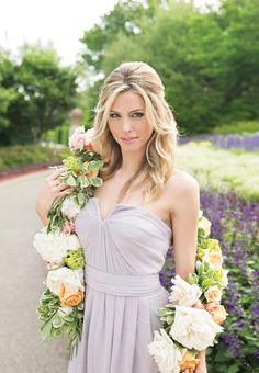 This bridesmaid ensemble is perfection with beauty by AW Wedding Hair and Makeup & floral wrap from Lush Couture Floral. Photo by Perez Photography. #wedding #bridesmaid #beauty #floral #floralwrap